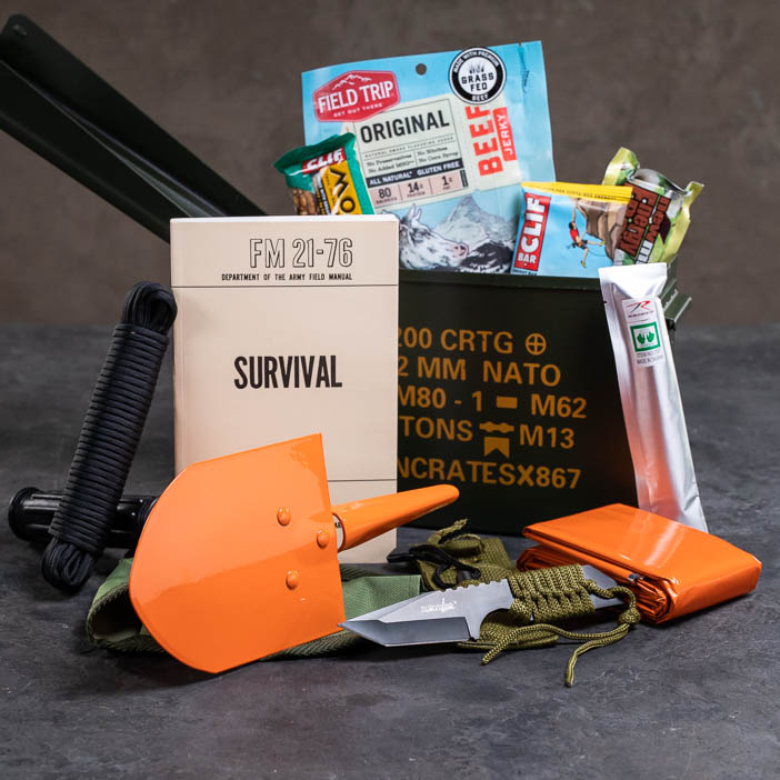 Outdoor Survival Ammo Can includes collapsable shovel, paracord, knife, firestarter, survival field manual, survival blanket, glow stick, and assorted snacks.