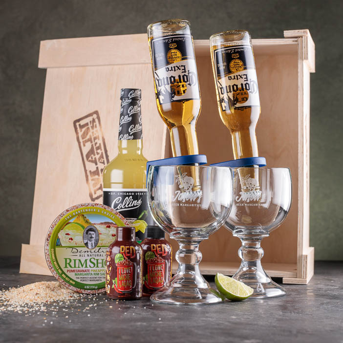 Margaritas glasses with beer bottles, salt, mix, and crate for a great men's drink gift.
