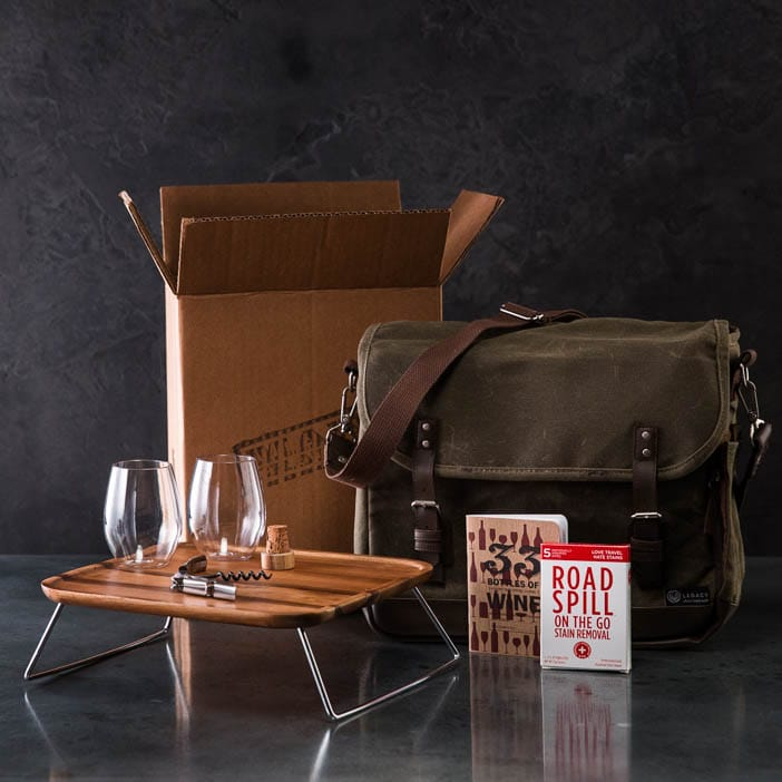 Wine Country Picnic Pack includes wine glasses, tote bag, bottle stopper, corkscrew, cutting board, wine journal, and wine stain removal towelettes.