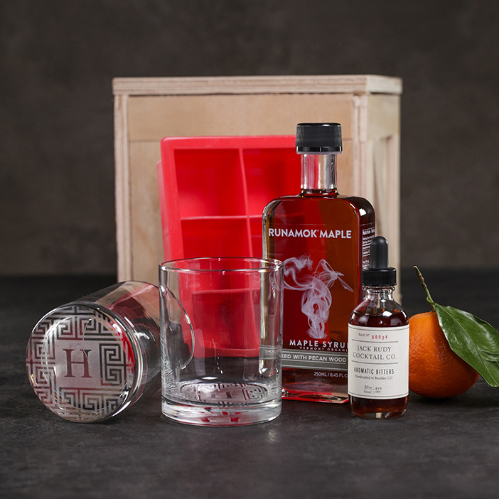 Smokin' Old Fashioned Crate includes smoked maple syrup, old fashioned glasses, ice molds, aromatic bitters, and a recipe book.