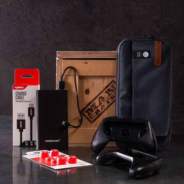 Switch Swag Crate includes charging cable, carrying case, thumb grips, rechargeable power pack, and controller handles.