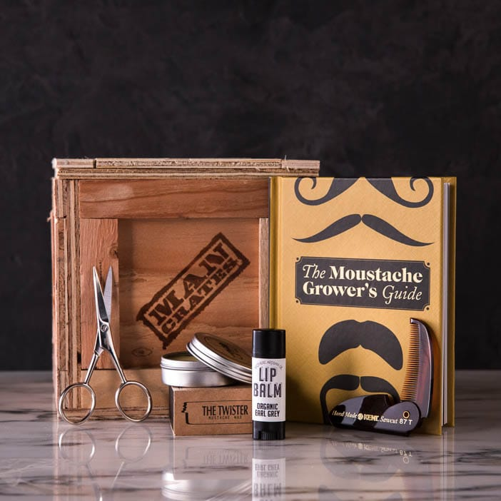 Dashing 'Stache Mini Crate includes mustache wax, comb, scissors, lip balm, and a mustache growing book.