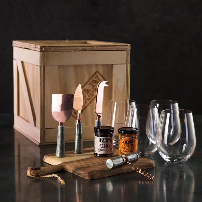 Wine Connoisseur Crate includes a cheese knife set, wine opener, cheese board, stemless wine glasses, jelly and jam for cheese pairings.
