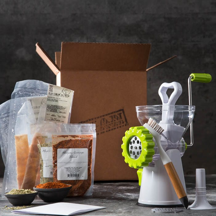 Sausage Making Kit includes sausage grinder, spice blends, cleaning brush, and sausage casings.