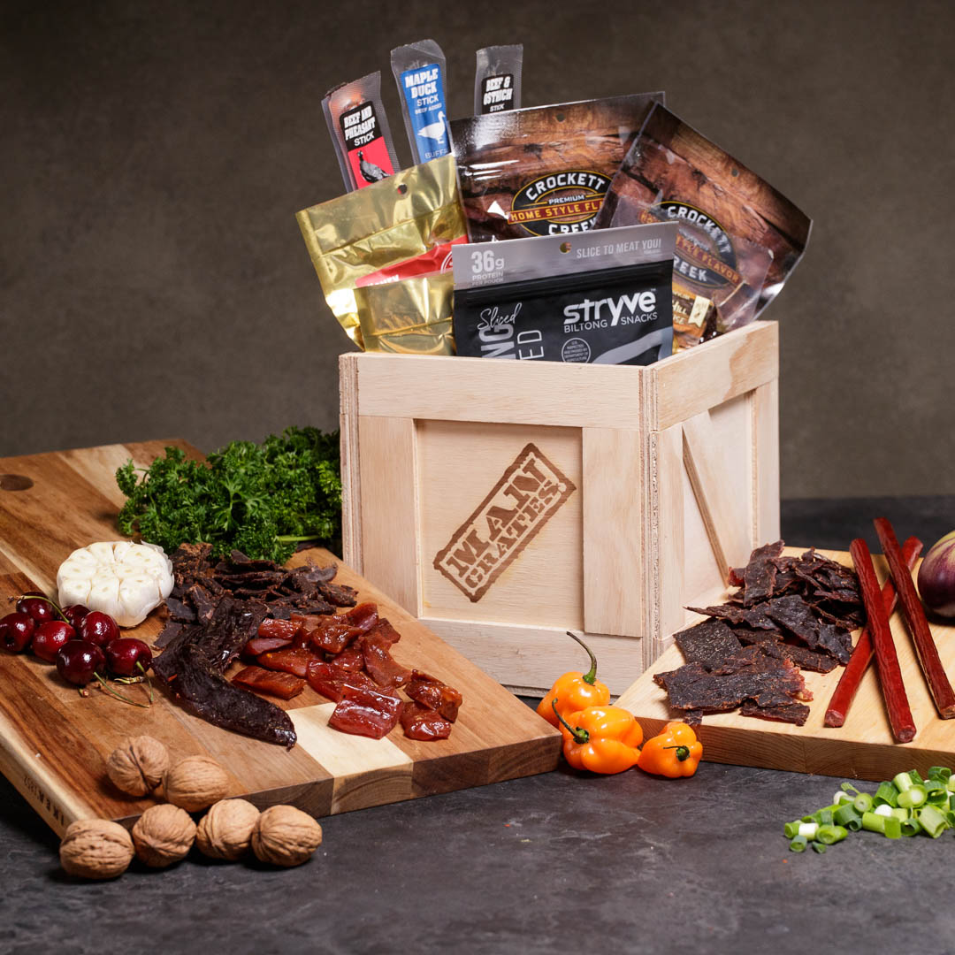 Exotic Meats Crate includes venison, wild boar, biltong beef, elk, buffalo, pheasant, duck, and ostrich jerkies.