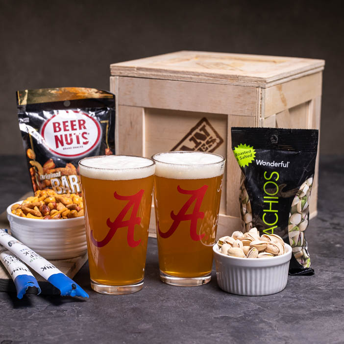 Man Crates College Barware Crate includes 2 glasses pistachios, beer nuts, and beef jerky, featuring Alabama Crimson Tide!