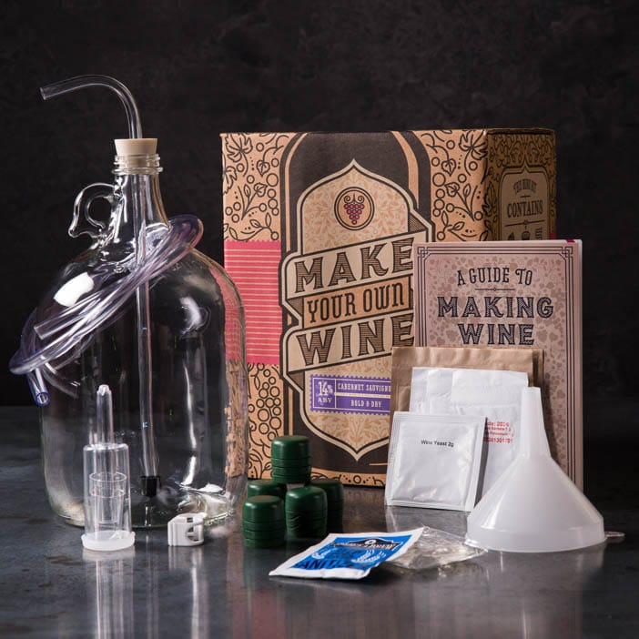 Winemaking Kit includes glass carboy, funnel, racking cane, rubber stopper, transfer tubing, tubing clamp, airlock, cabernet sauvignon juice with yeast, and a wine making book.