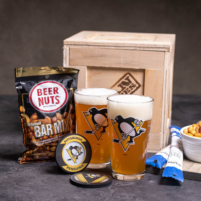 NHL logo'd glasses with snacks, bottle opener, and crate is a great men's sports gift.