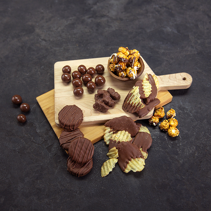 Chocolate covered potato chips, nuts, popcorn, and cookies is a great men's snack gift.