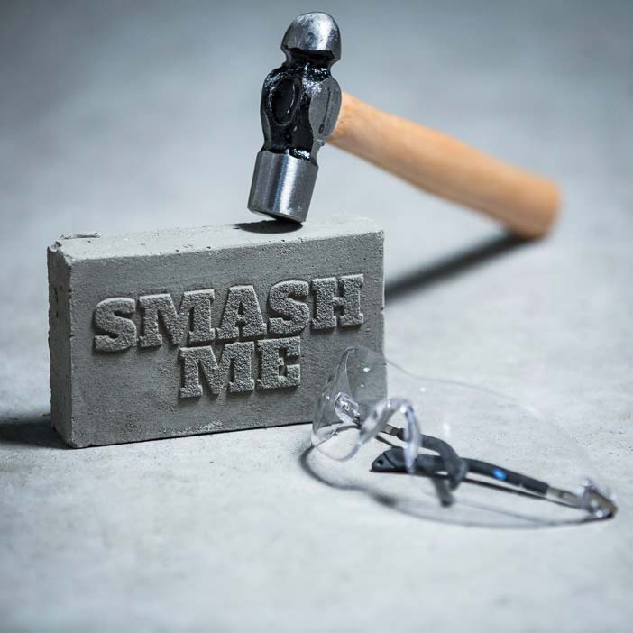 Smash & Grab Gift Card includes a gift card encased in concrete, hammer, and safety goggles.