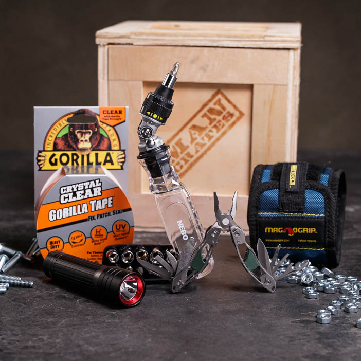 Tape, flexible screwdriver, flashlight, nuts and bolts, and crate for men's DIY gift.