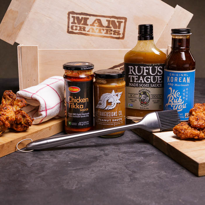 Sauces, brush, wings, and a crate make a great men's cooking gift.