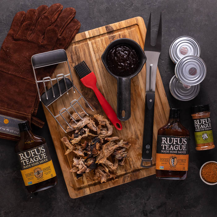 Pit Master Crate overhead view of tools and sauces grilling gifts.