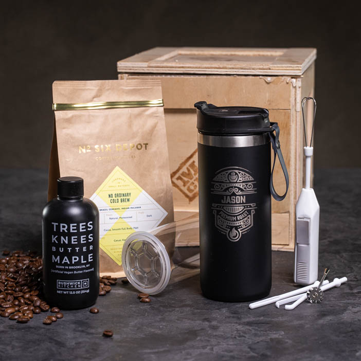 Portable French Press, stirrer, maple syrup, and coffee beans with a Crate make a great men's drink gift.