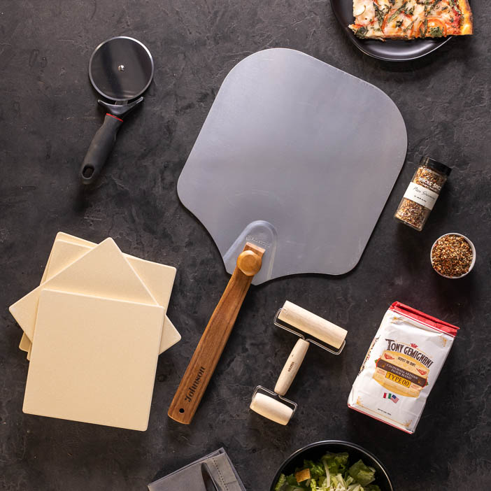 Personalized Pizza Grilling Crate overhead: pizza peel, pizza stone, pizza cutter, pizza roller, pizza flour, pizza seasoning