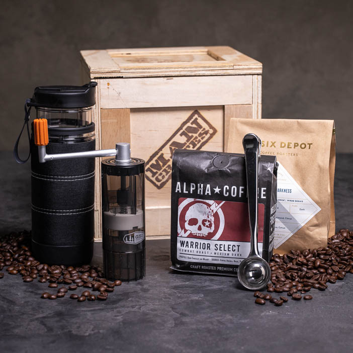 Caffeine Fiend Crate includes portable grinder, French press thermos, spoon/clip, and coffee beans.